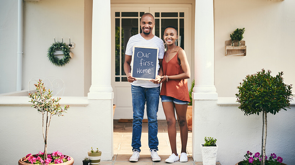 Couple buying their first home